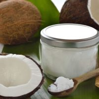 18403629 - coconuts and organic coconut oil in a glass jar on white background  hair treatment